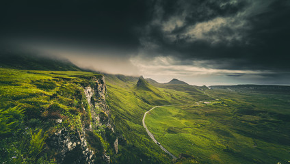Photo sur Plexiglas Colline Dramatic Rainy Clouds over Scottish Highlands in the Isle of Skye