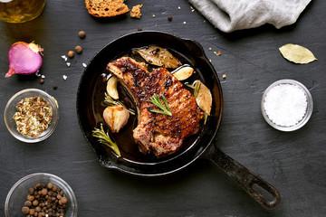 Grilled pork steak in frying pan