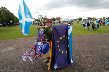 Man sells flags on Glasgow Green at a march in support of Scottish independence in Glasgow