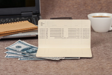book note and laptop with money on table