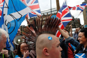 Demonstrators wave flags at march for Scottish independence in Glasgow