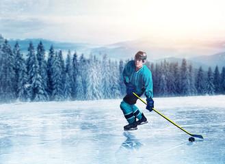 Hockey player in uniform on frozen lake