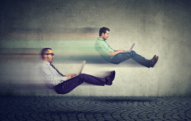 Fast internet concept. Two levitating business men on road using laptop Wall mural