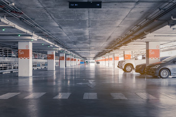 interior of parking garage with car and vacant parking lot