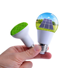 Hand holding eco LED bulbs isolated on a white background. The concept of sustainable resources.