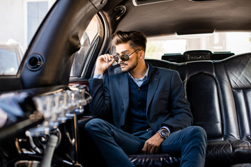 Young attractive business man in limo