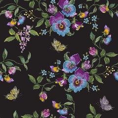 Embroidery trend floral seamless pattern with pansies and butterflies. Vector traditional embroidered flowers decor on black background for fabric design.