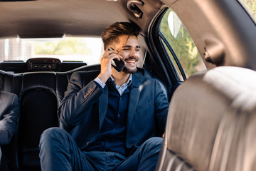 Young businessman in limo