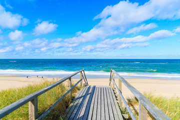 Fototapete - Walkway to beautiful beach in Westerland village on Sylt island, North Sea, Germany