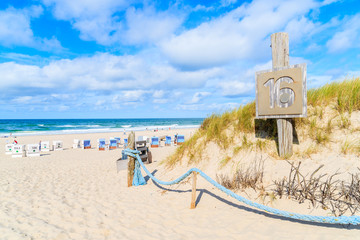 Fototapete - Entrance to sandy beach in Kampen village, Sylt island, North Sea, Germany