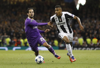 Juventus' Alex Sandro in action with Real Madrid's Isco