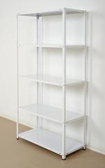 white metal rack near the wall, empty shelves