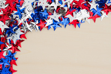 USA red, white and blue stars on wood background