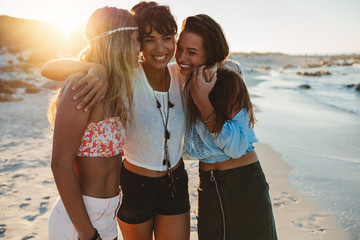 Group of beautiful young women enjoying beach vacation