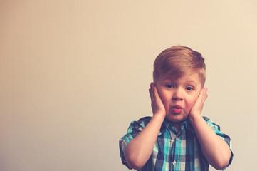 Portrait of surprised and amazed caucasian boy