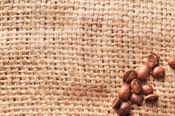 Coffee beans on a burlap background