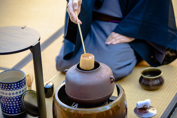 Japanese tea ceremony - man preparing a tea