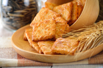 Tasty biscuits in wood plate