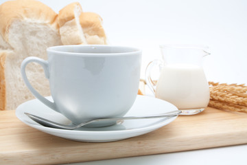 Breakfast with coffee and bread isolated