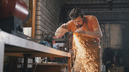Sharpening iron tools with sparkles - forge workshop