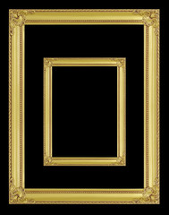 The antique gold frame on the black background