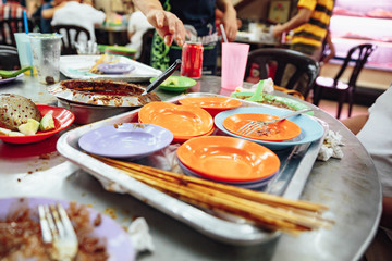 Empty color plates when you finished satay. Satay is a dish of skewered grilled meat with Javanese origins in Malacca City, Malacca, Malaysia.