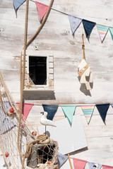 Outdoor photo zone with sea theme decoration. Summer vacation street photozone, flags, seagulls waiting for tourist to rest or make a selfie photo.