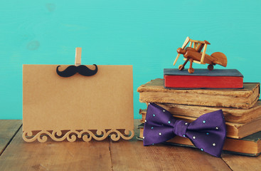funny mustache, greeting card, bow and books. Father's day concept