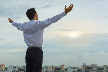 Asian man starting his morning on a to-be successful day