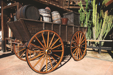 Old wooden cart with wine barrels.Wild West. Retro photo with historical transport