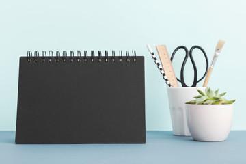 Calendar mock up on blue shelf or desk.