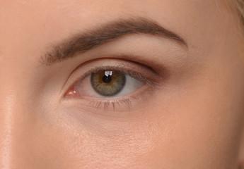 Closeup of beautiful woman eye with makeup