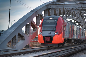2017, 15 APR Red speed train goes through the iron bridge at the centre of the Moscow, Russia
