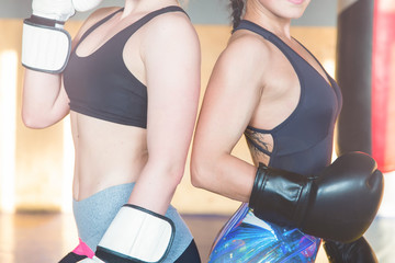 Two boxer girls are training