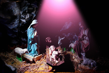Christmas, Infant Jesus lying in manger in rays of divine light
