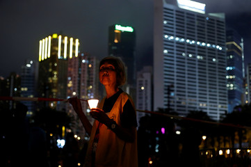 A woman takes part in a candlelight vigil to mark the 28th anniversary of the crackdown of the pro-democracy movement at Beijing's Tiananmen Square in 1989, at Victoria Park in Hong Kong