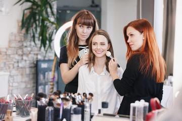 Makeup artist makes evening bright make up for model