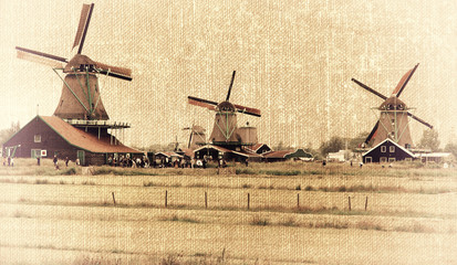 Traditional Dutch windmills in the style of old photography. Zaanse Schans. Holland.
