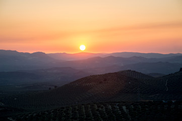 Panoramic and idyllic Andalusian landscape, mountain village Alcaudete at sunset