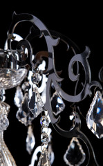 Metal silver chandelier details, modern style isolated on black background.