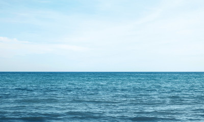 Vacation, travel and background concept - blue sea or ocean with sky
