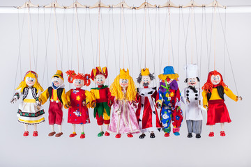 The raw of different puppets