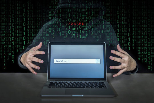 Hacker using adware fireball to control laptop computer using web browser search engine to spy and steal information. Internet security cyber attack hijack concept.