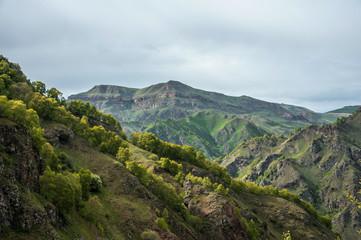 beautyfull Green Caucasus Mountains on foggy sky