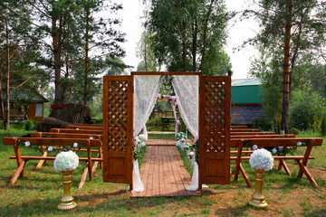 fragment like view of nice chairs and arch ready for wedding ceremony.