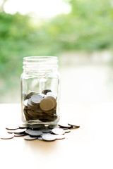 Coins Into Glass Jar