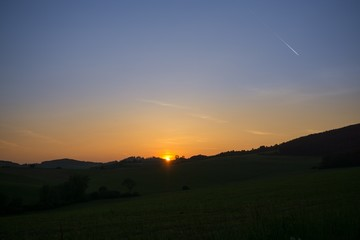 Sunrise and sunset over the hills and town. Slovakia