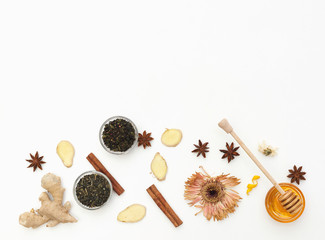 Tea with ginger and honey over white background. Flat lay composition