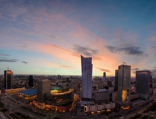 Panorama of Warsaw city with modern skyscraper in sunset time