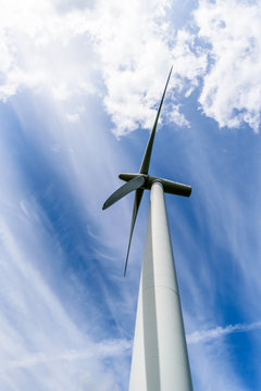 Day view wind power turbines generate electricity
